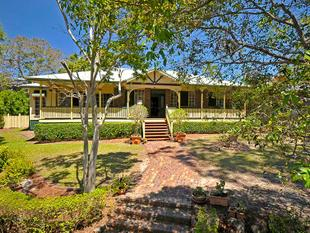 A quintessential Queenslander situated on a 1404m2 block over looking Parkland - Robina