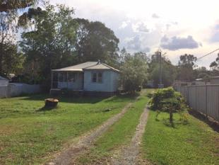 1/2 acre block in town!! - Clarence Town