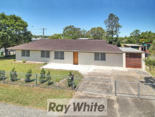RENOVATED & LIKE A BRAND NEW HOME! - Logan Central