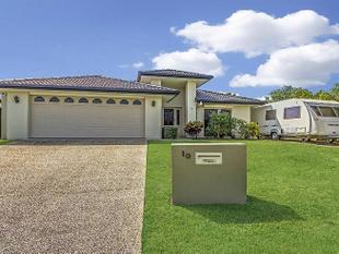 WITH THIS SPACIOUS FAMILY HOME - Robina