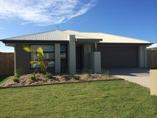 THIS FULLY AIR CONDITIONED FOUR BEDROOM HOME IS BRIGHT, FRESH AND AIRY LOCATED IN SHOAL POINT - Shoal Point