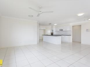 CALL TO ARRANGE AN INSPECTION NOW! Lowset home with 5 bedrooms and huge living spaces! - Redland Bay