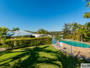 An in-ground pool providing a tropical oasis in your own back yard - Eatons Hill