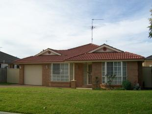 Great Value- immaculate 4 bedroom home with ducted air con and new carpet! - Beaumont Hills