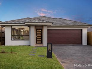 BRAND NEW SINGLE LEVEL FAMILY HOME IN A SOUGHT AFTER LOCATION - Schofields