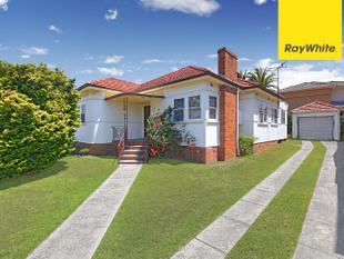 FAMILY HOME IN A COMMANDING POSITION - Lidcombe